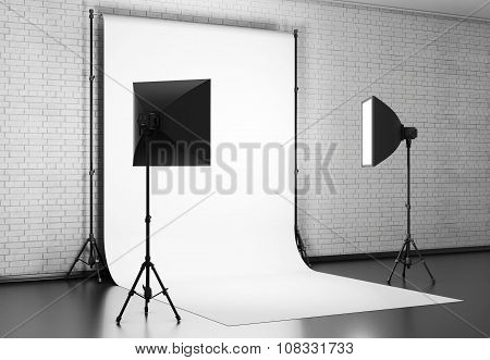 White Background Lit With Studio Equipment Against A Brick Wall. 3D.
