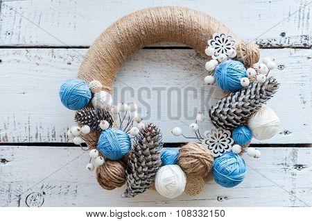 Christmas wreath with decorations, cones, clews on white background