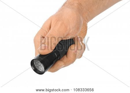 Flashlight in hand isolated on white background