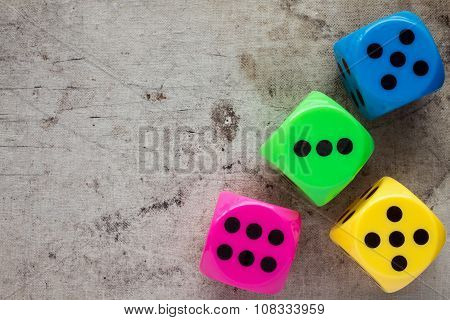 Dices On Old Canvas Background