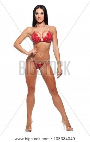Full length photo of sporty woman in bikini isolated against white background