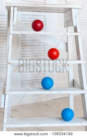 Colour plastic balls on wooden stairs for background