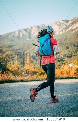 young girl running mountain marathon