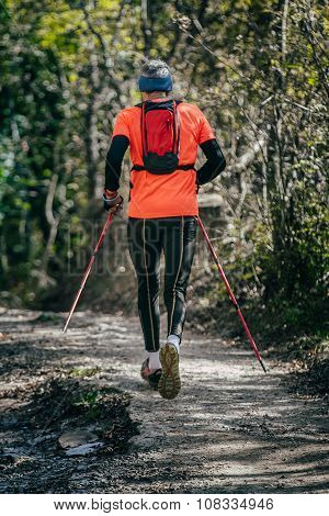 elderly athlete man running mountain marathon along a forest trail