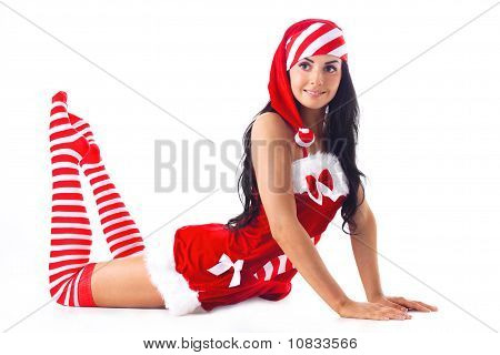 Santa Girl Is Raising Your Feet Up. Holidays Christmas And New Year.