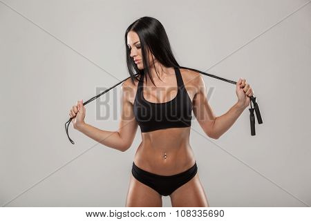 Sport, exercise and healthcare - sporty woman with skipping rope