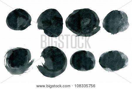 Black ink round shapes isolated on white background.