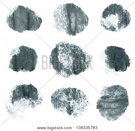 Gray ink round shapes isolated on white background.