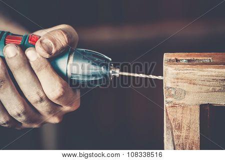 male carpenter at work close up