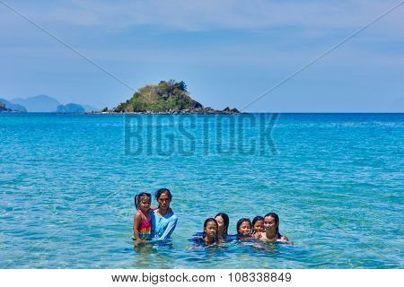 Nacapan Palawan Philippines-April 5, 2015 :filippino natives people bathing on a island between El Nido and coron in Palawan Philippines