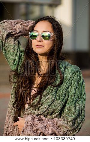 Beautiful Young Brunette Girl Walking Down The Street