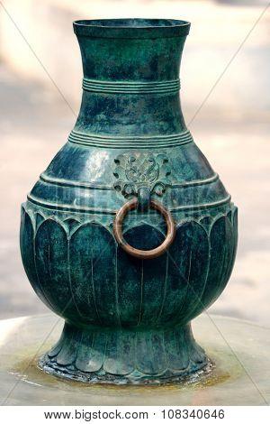 Bronze ancient container in Beihai Park in Beijing.