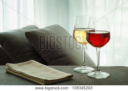 Two Glasses Of Red And White Wine In A Living Room