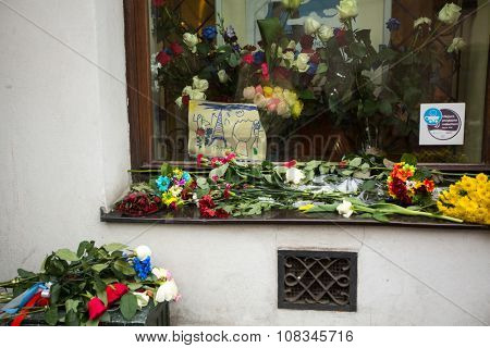 KRAKOW, POLAND - NOV 16, 2015: People put candles and flowers near the General Consulate of the French Republic to Krakow. Mourning for the victims of the terrorist attacks in Paris 13 Nov 2015.