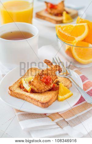 Bunny shaped toast with jam, juice and tea
