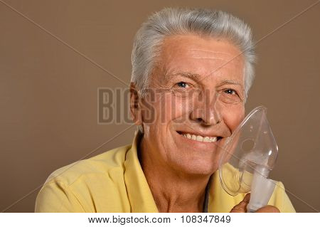Elderly man with flu inhalation