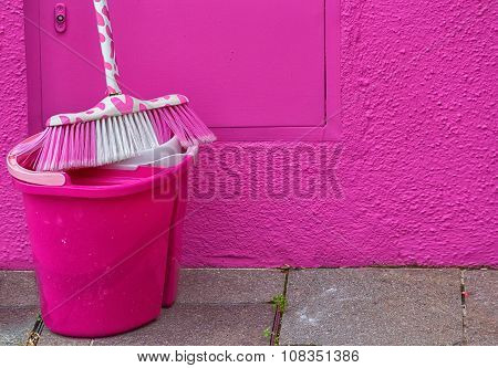 Pink Bucket And A Mop Standing Near A Pink Wall, Close-up