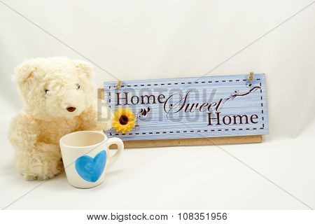 Home Sweet Home Label With White Teddy Bear And Cup