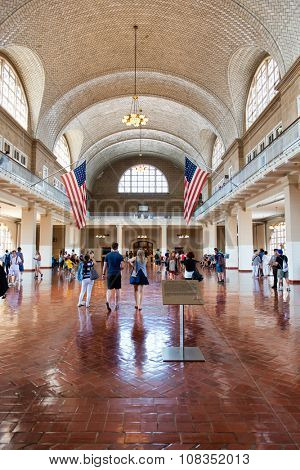 NEW YORK - SEPTEMBER 02: Tourists Wandering Through Great Hall of Ellis Island Immigration Museum - Historic Location Where New Immigrants Were Processed - New York City, USA. September 02, 2015.