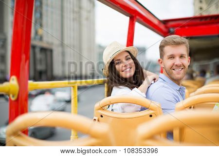 Smiling couple in a tour bus