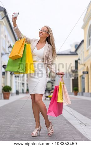 Young girl with bags in shopping outlets