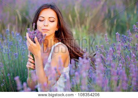 Beautiful woman on lavender field