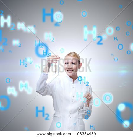 Attractive doctor hands graduated cylinder and Erlenmeyer flask, isolated on white