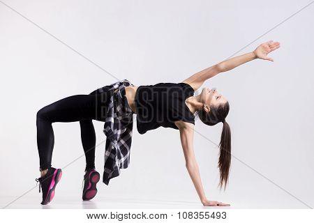 Teenage Dancer Doing Bridge Exercise