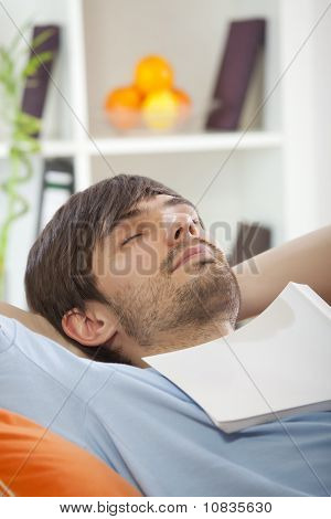 Man With Book Sleeping