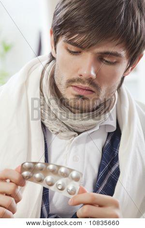 Sick Man With Medicine Pills