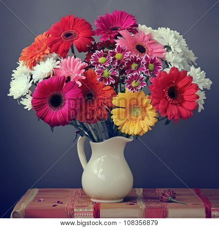 Still Life With A Bouquet Of Transvaal Daisies In A White Jug.