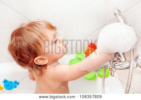 Baby Playing With Foam And Water Tap