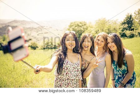 Group Of Girls Taking Selfie In The Nature