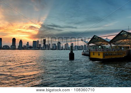 NEW YORK - CIRCA AUGUST 2015: Scenic View of Manhattan Skyline at Sunset with Heavy Dramatic Clouds as seen from Ferry Dock in New Jersey Across Hudson River. Circa August 2015 in New York, USA