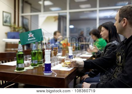 ST. PETERSBURG, RUSSIA - OCTOBER 24, 2015: Tourists during tasting session at the Baltika - St Petersburg brewery. This session is a part of the October Beer Festival celebrations