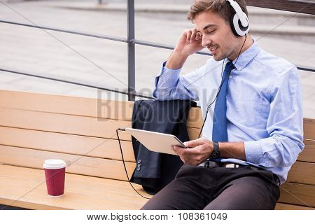 Businessperson Listening Music And Waiting