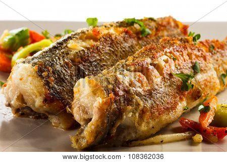 Fish dish - fried fish and vegetable salad