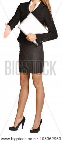 Woman headless stretches out a hand of greeting. holds clipboard