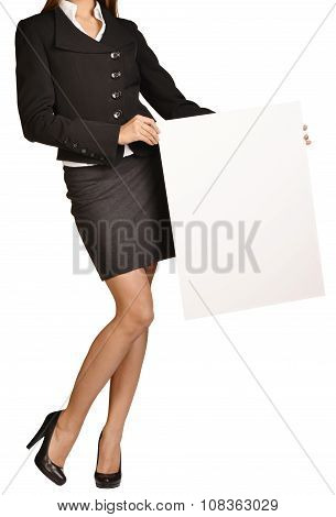 Woman headless holding a blank white board