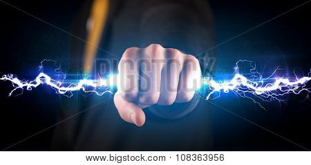 Business man holding electricity light bolt in his hands concept