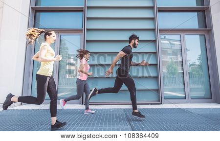Group Of Friends Making Urban Running And Fitness