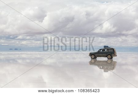 Car moving on lake Salar de Uyuni