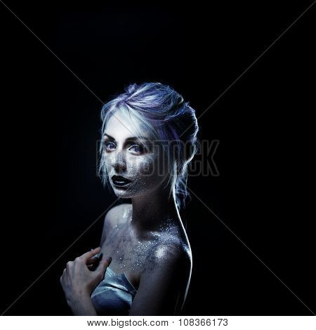 Unusual girl with bright fashion makeup, creative body art on theme space and stars.