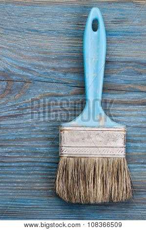 Used Paint Brush On Blue Wooden Board With Place For Text