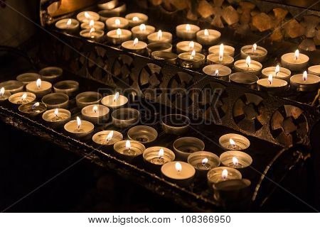 Candles Lit The Parishioners In The Catholic Church. Religion