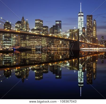 Manhattan Waterfront Reflected In Water At Night, Nyc, Usa.