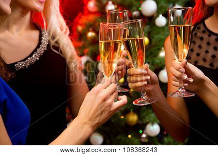 Image of women's hands with crystal glasses of champagne