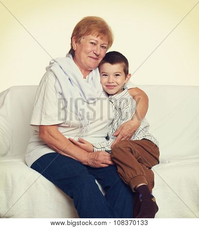 portrait of child boy and grandmother on white, happy family concept