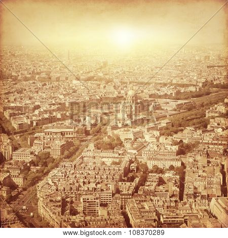 Aerial view of Paris at sunset. Grunge and retro style.