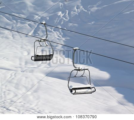 Two Chair-lift With Snowdrift And Off-piste Slope In Sun Morning